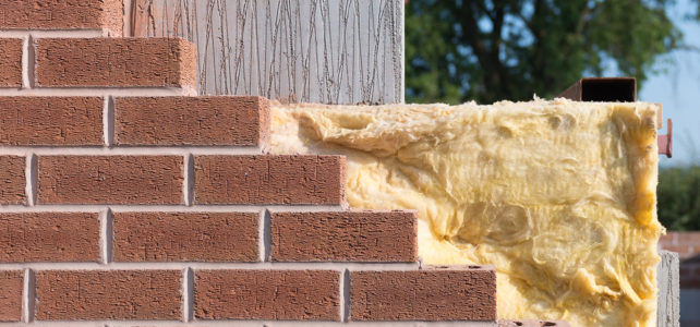 Why were cavity walls introduced?
